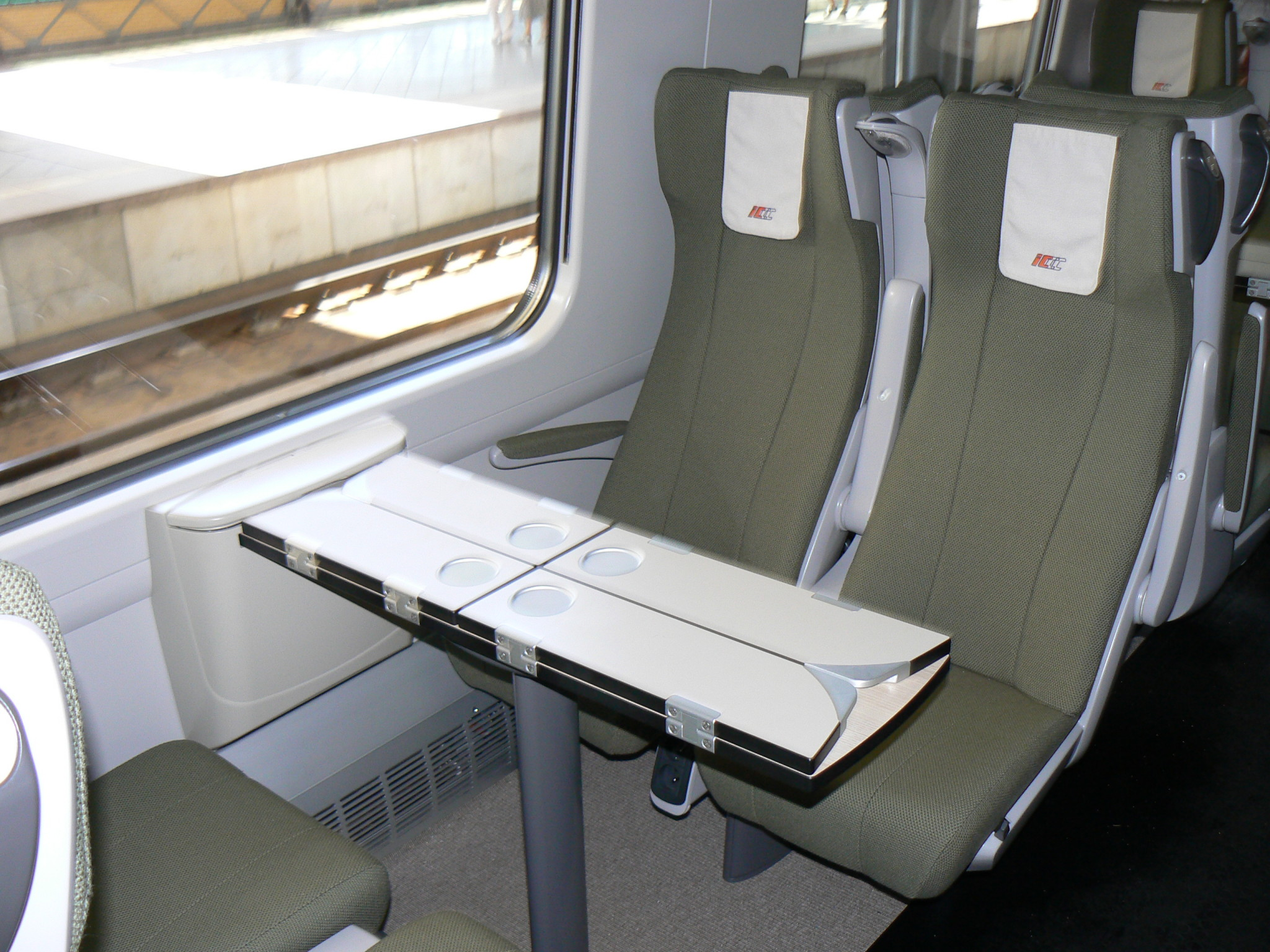 The interiors of many Western European trains are comparable to that of this new Polish Pendolino. (Are those folding tables? And power outlets??)