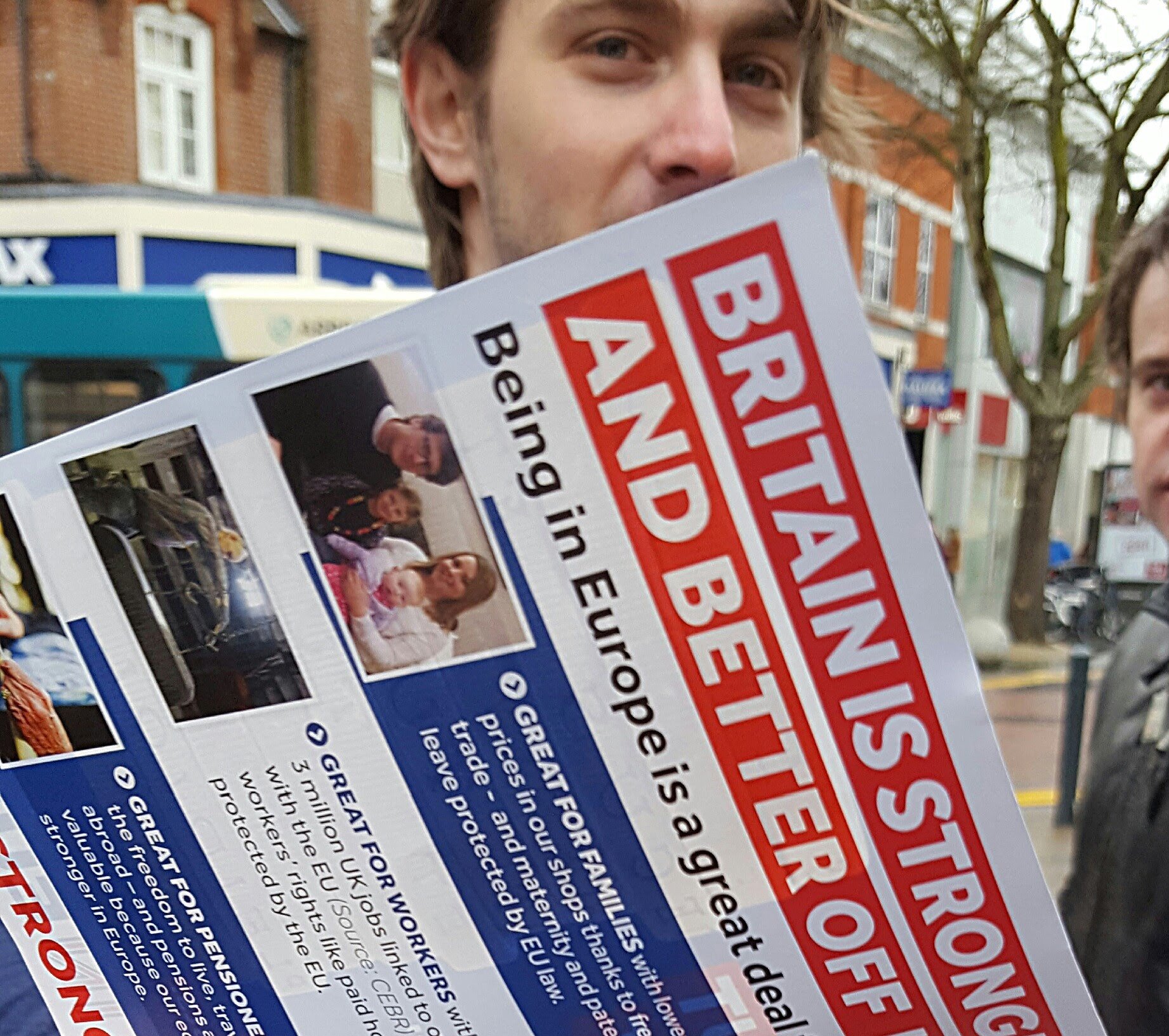 BREXIT: A Briton reads a flier supporting continued EU membership
