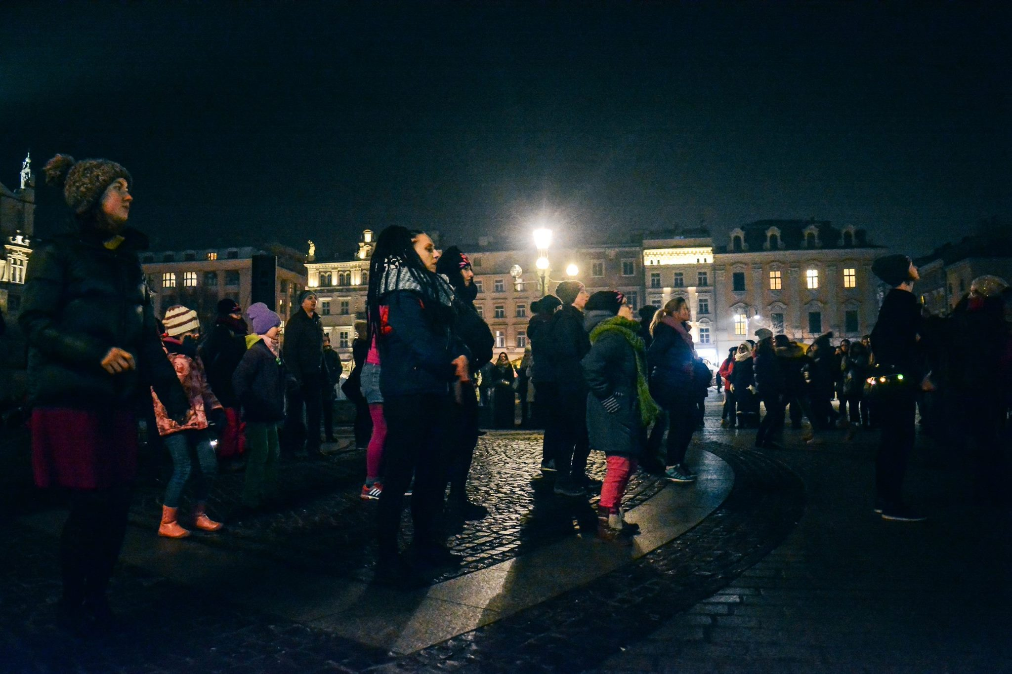 Cracovians dance on the Main Square to bring awareness to the issue of date rape (Aparat Partyjny/Facebook)