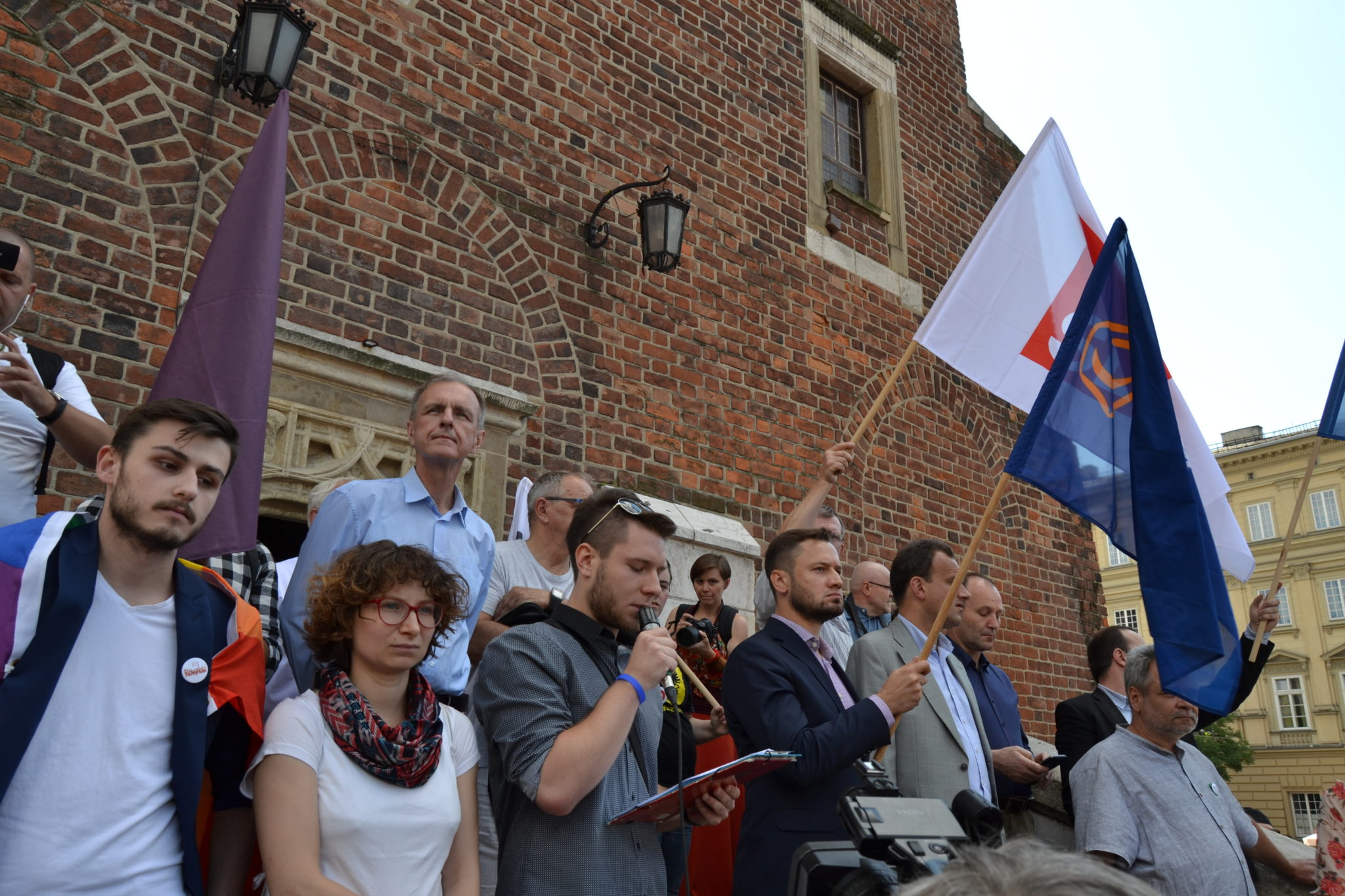 Leaders of various political parties and organizations assemble on the steps of Krakow's Town Hall Tower to speak out against the bill by PiS