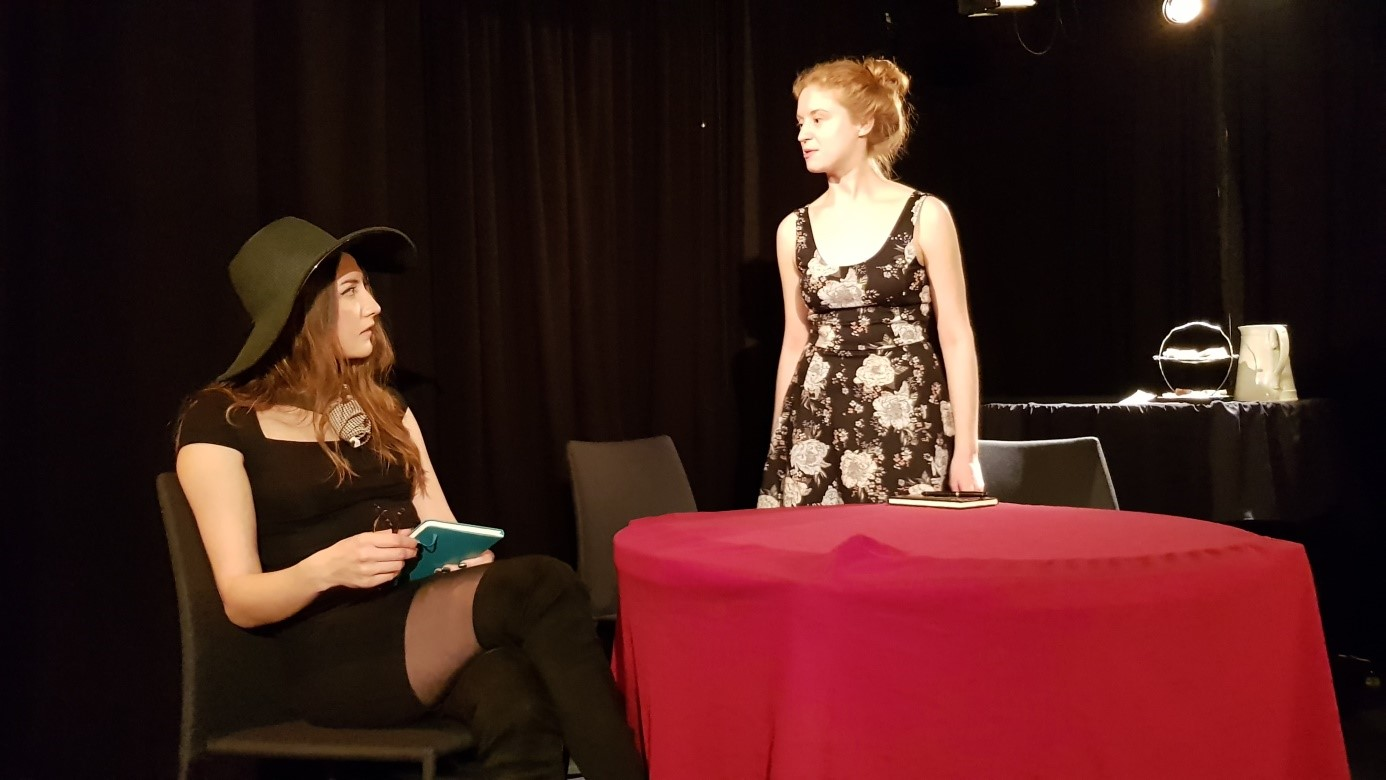 Gwendolen (Megan Welle) is intrigued by the existence of Cecily (Ina Knap)