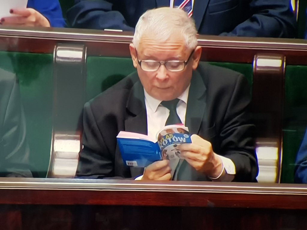 PiS leader Jarosław Kaczyński reads Atlas of Cats: Wild and Domestic as the Polish parliament debates controversial changes to the judicial system