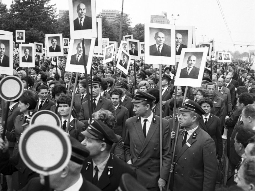 Uniformed railway workers hold up the image of PRL leader Władysław Gomułka in the 1968 Labor Day parade in Warsaw
