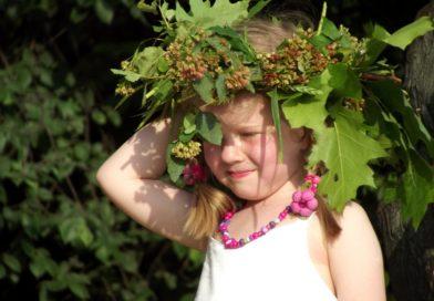 A young girl wears a traditional Wianki wreath (phot. Piotr Drabik)