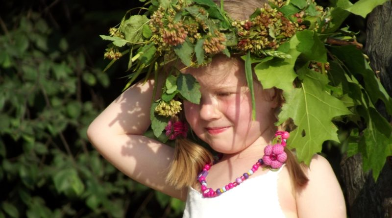 A young girl wears a traditional Wianki wreath (phot. Piotr Drabik)