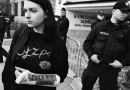 """An image from Amnesty International's report. At a peaceful counter-protest of a nationalist march in Warsaw, Anna reports she was detained in a police van for 1.5 hours without explanation and in the process suffered dislocation, sprain and tearing of joints and ligaments in her hand and wrist. Her cast says """"THE POLICE DID THIS TO ME"""". (phot. JohnBob & Sophie Art)"""