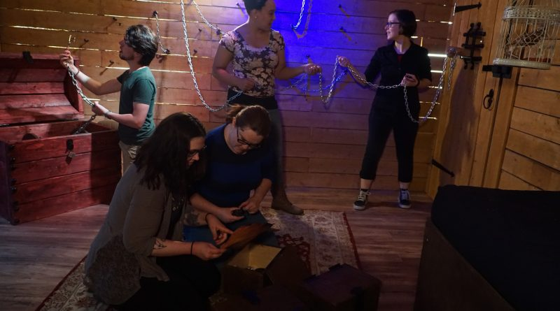Escape room participants try to solve puzzles to get out (phot. David Hoffmann)